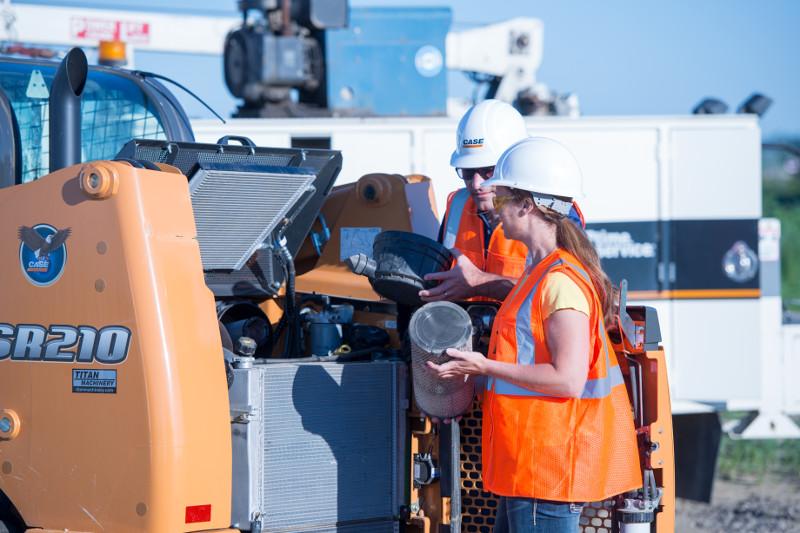 The Eagle service team servicing a Case skid steer