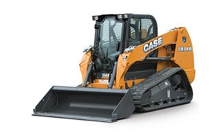 A yellow Case skid steer