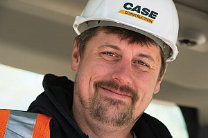 Eagle Power & Equipment service team member wearing a Case Construction hat