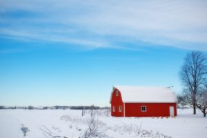 Red barn covered in snow
