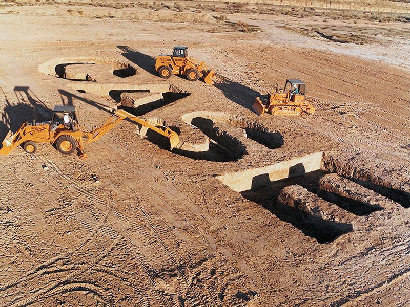 CASE written in dirt by 3 CASE tractors